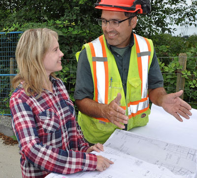Eric shares plans with Bronwyn, at the start of an exciting new timber frame project.